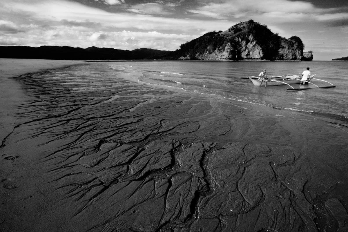 Part of the 7.5 km-long causeway of mine tailings flowing into Calancan Bay.