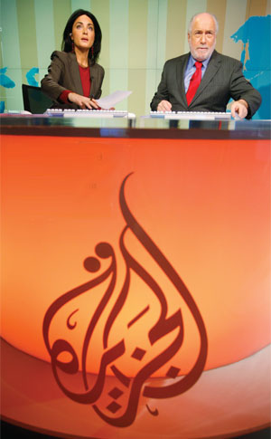 Washington-based TV anchors Marash and Fakry of the Al Jazeera English language network. Photo by Jason Reed/Reuters.