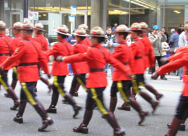 "RCMP officers marching on Remembrance Day in Vancouver. Creative Commons photo by Flickr user ""SqueakyMarmot"""