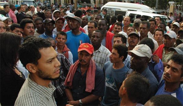 "Juan Pablo Ochoa, left, addresses a crowd of cane cutters in Bua, Colombia after a court hearing related to their strike. ""What is going on is a frame-up."" Photo credit: Dawn Paley."