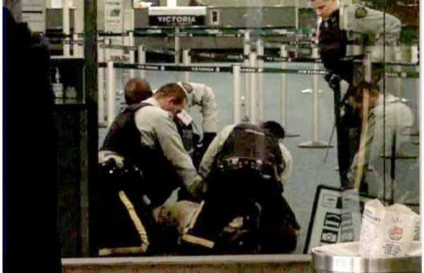 Robert Dziekanski being restrained by RCMP officers in Vancouver International Airport, October 14, 2007, in amateur video of the incident.