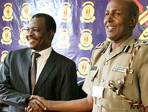 Outgoing Kenyan police commissioner Hussein Ali shakes hands with his successor, Mathew Iteere. Photo courtesy Daily Nation.