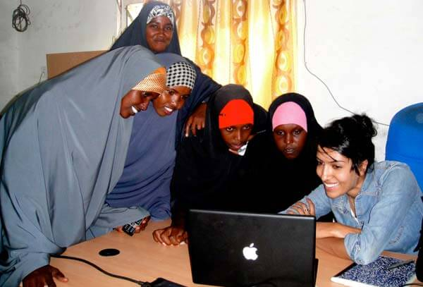 Women in the Dadaab, Kenya refugee camp receiving training to work with Samasource, a web company that outsources computer jobs to women, youth, refugees, and internally displaced people living in poverty. Photo courtesy Samasource.