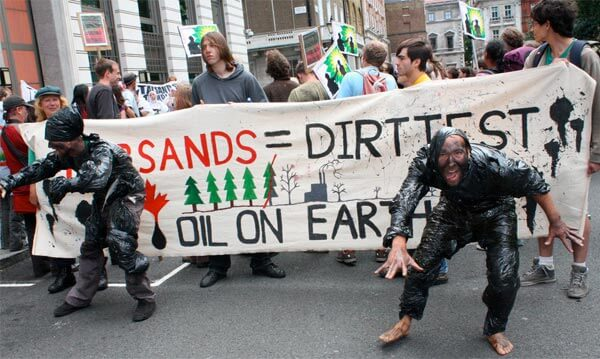 Protesters demonstrating Canada's tar sands development outside the Canadian High Commission in London. Photo by Zoe Cormier.
