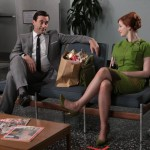 "Don Draper (Jon Hamm) and Joan Holloway (Christina Hendricks) speculate on the future of their newly disabled colleague in ""Guy Walks Into an Advertising Agency""--copyright AMC 2009"