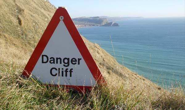 We can read the signs, but can we stop from falling off the edge? Photo by Panoramio user jk1812.