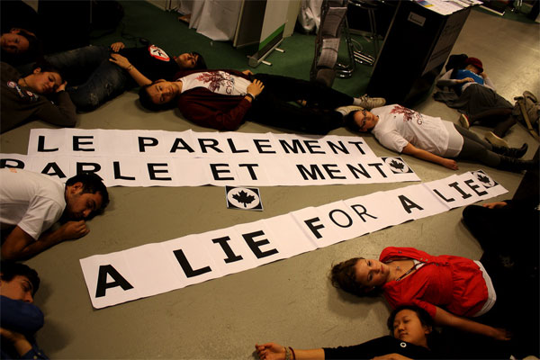 "Canadian Youth Climate Coalition members stage a ""Lie-in"" to protest the Canadian government's reduced carbon reduction targets. Creative Commons photo courtesy CYCC."