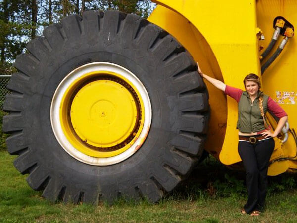 Emily Hunter with one of the huge earth-movers that's instrumental to Alberta Tar Sands development. Watch her documentary tonight on MTV.