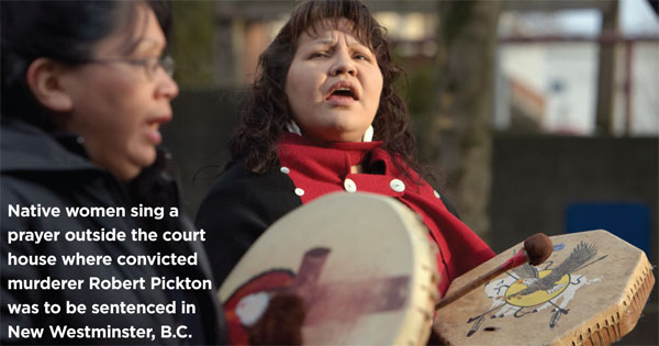 Native women sing a prayer outside the court house where convicted murderer Robert Pickton was to be sentenced in New Westminster, B.C., December 11, 2007