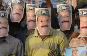 Tamil protesters wear masks of LTTE leader Velupillai Prabhakaran. Photo by Babu Babu/Reuters.