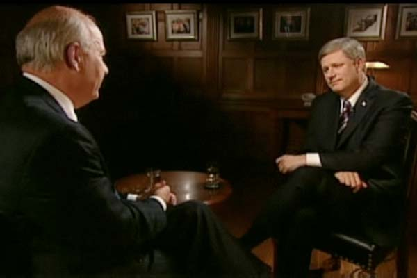 Peter Mansbridge interviewing Stephen Harper on CBC's the National, January 5, 2010. Screenshot from CBC broadcast.