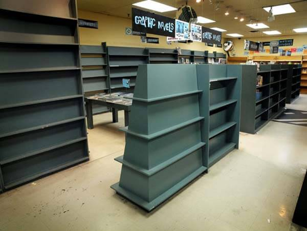 Pages Books' bare shelves in its final days of business. Photo by Rick McGinnis.