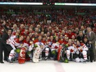 Canada's women's Olympic hockey team pose with their gold medals after the winning game.