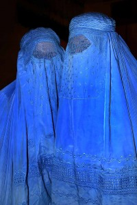 Two Afghan women wear burkas in Northern Afghanistan. Creative Commons photo by Steve Evans.