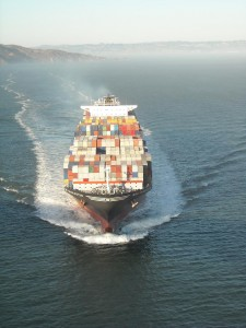 A container ship carrying cargo. Slowing the pace of shipping can save money and carbon