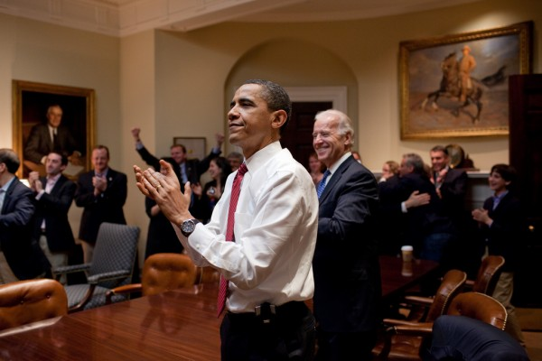 President Barack Obama, Vice President Joe Biden, and senior staff, react in the Roosevelt Room of the White House, as the House passes the health care reform bill, March 21, 2010. (Official White House Photo by Pete Souza)