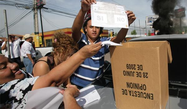 Honduran citizens cast their votes in defiance of a military coup that ousted Honduran President Manuel Zelaya and cancelled planned elections. Photo by Oswaldo Rivas/Reuters.