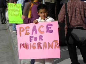 At a protest against Arizona's SB 1070 law that allows police to demand proof of citizenship. Creative Commons photo by Flickr User Fibonnaci Blue.