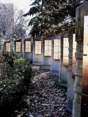Concrete slabs and plaques with names at the AIDS memorial at 519 Church Street Community Centre, Toronto. Photo courtesy of Kenn Chaplin at Flickr.