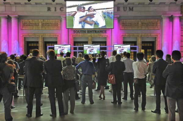 International media watch the World Cup as the G20 protests continue outside.