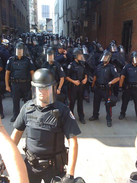 Riot police in alleyway on College Street.