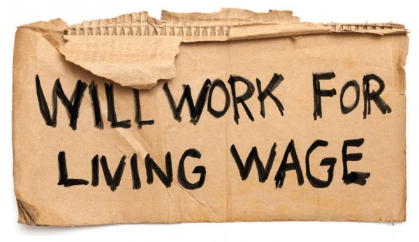 cardboard sign reading Will Work for Living Wage