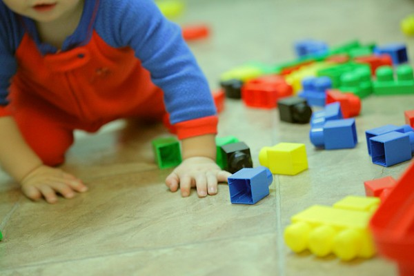 Toddler with blocks in disarray