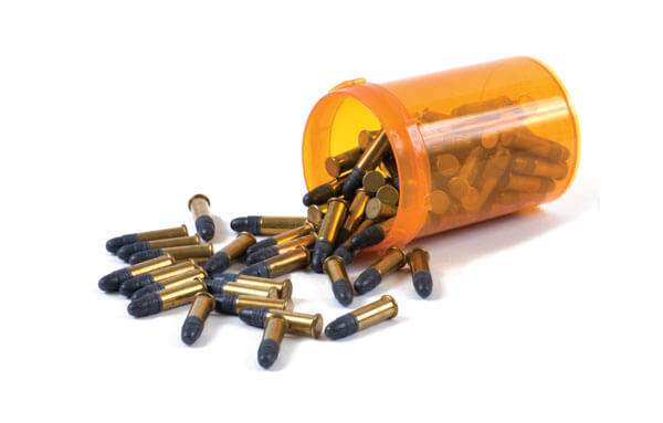 Bullets spilling from a pill container