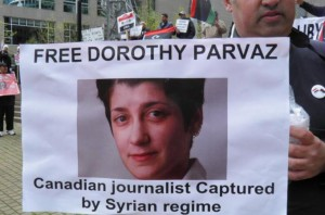 A protester at a Vancouver demonstration calling for Canadian al Jazeera journalist Dorothy Parvaz to be freed by Syria's government. Photo by al Jazeera/Isaac Oomen.