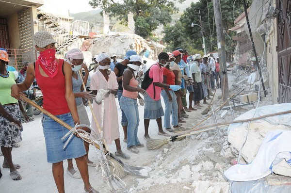 Haitian workers clear rubble from a street following the January 12, 2010 quake that devastated Haiti. Photo courtesy UNDP.
