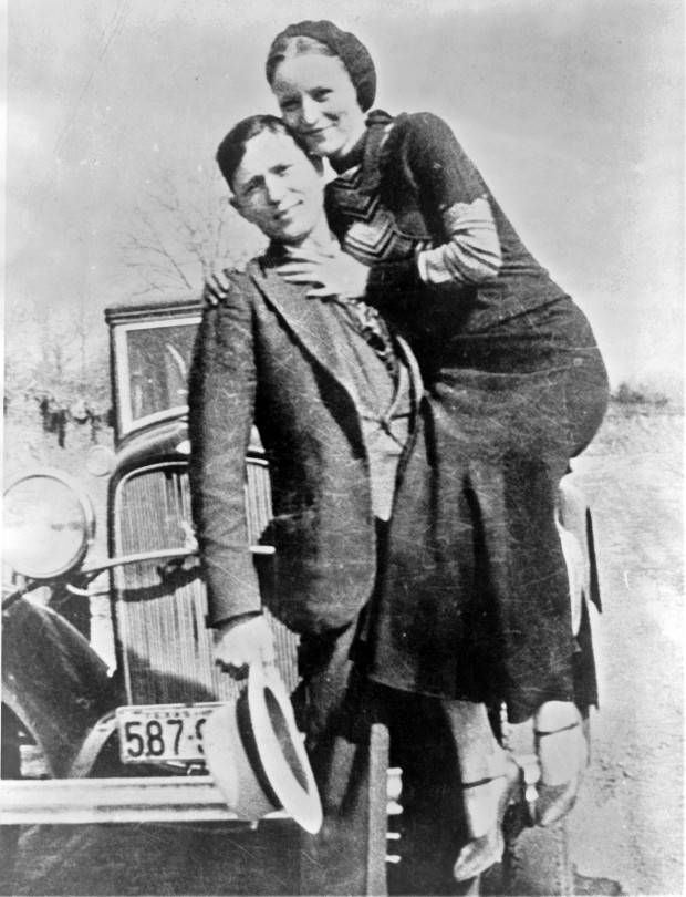Bonnie and Clyde with their car, 1933