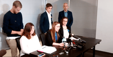 Screenshot of video from a UBC graduate press conference held November 21.