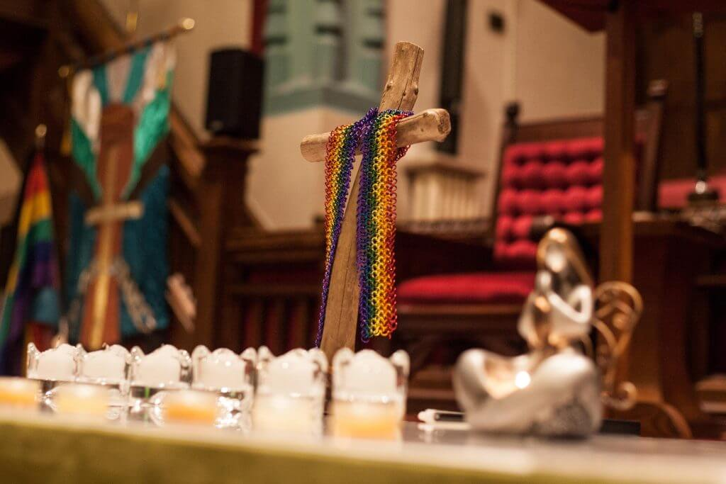 Rainbow chainmail draped over a cross during a community vigil for victims of alleged serial killer Bruce McAurthur. February 4th, 2018